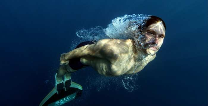 man freediving