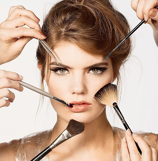 Posed by model picture of a woman appling Make-up to her face for her christmas party