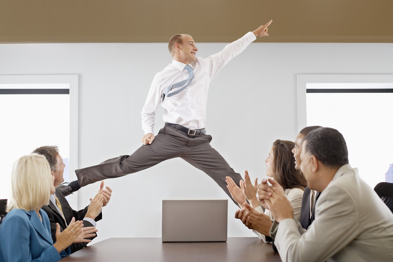 Businessman Midair in a Business Meeting --- Image by © Royalty-Free/Corbis